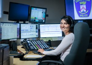 911 operator at her station