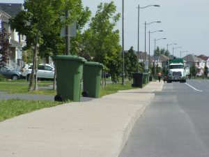 Garbage bins on the sidewalk