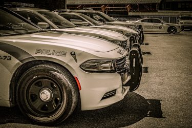 Police cars in a parking lot