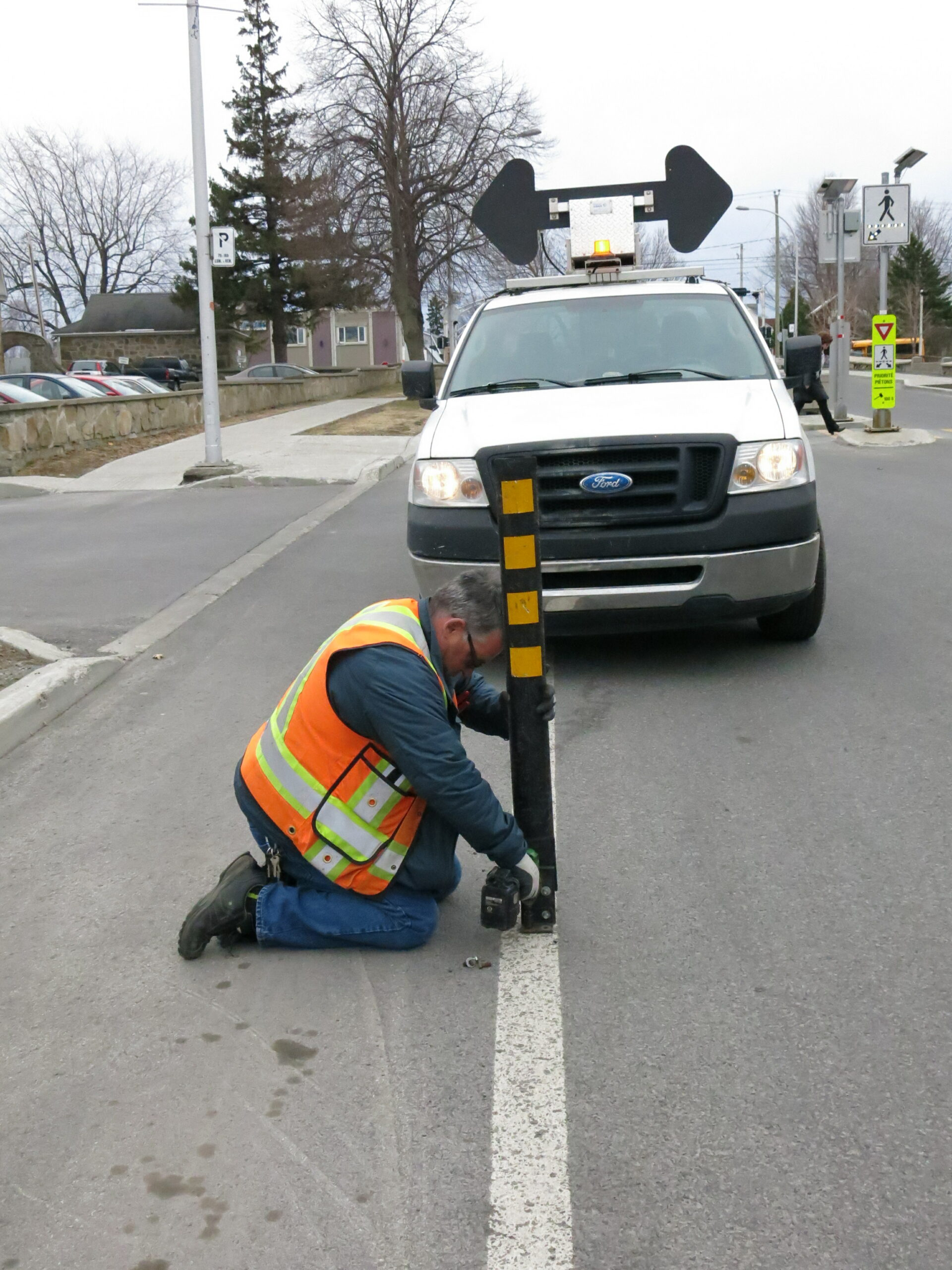 worker removing bollards on cycling trails