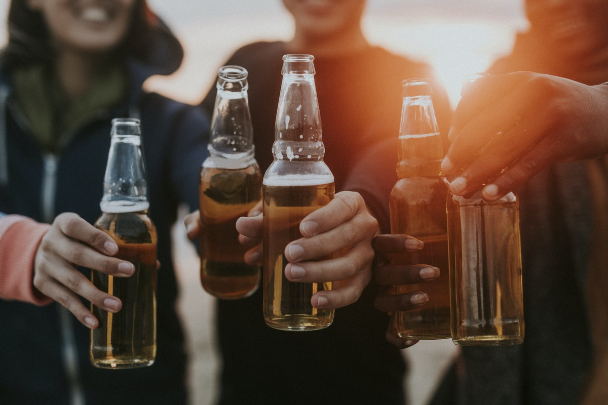 friends drinking a beer