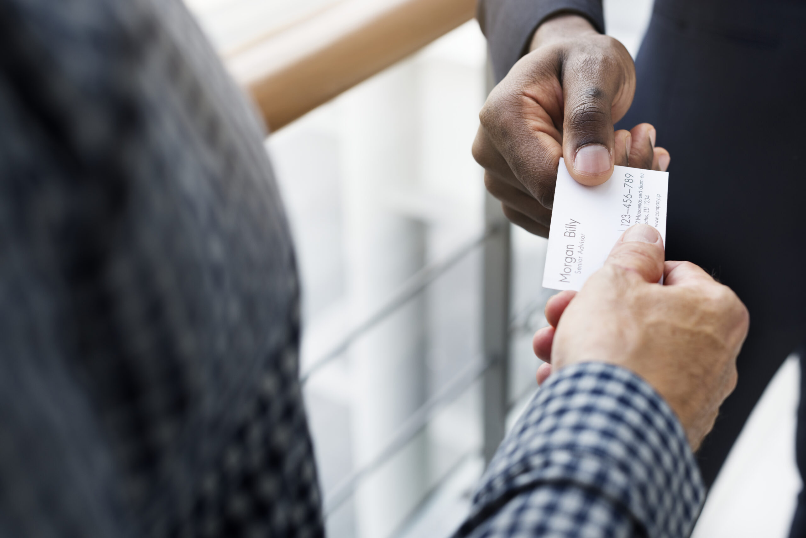 Men exchanging a business card