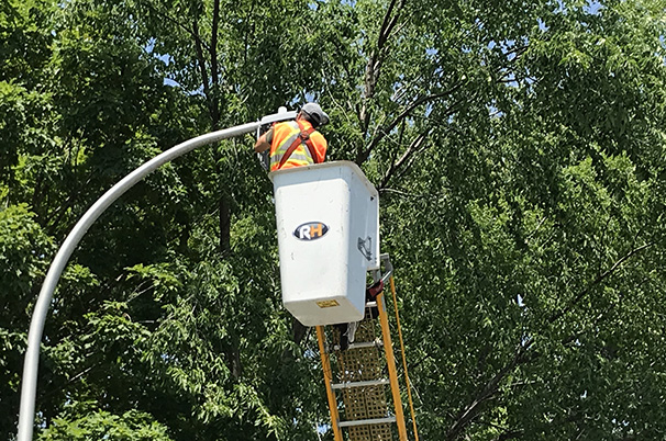 Worker fixing street light